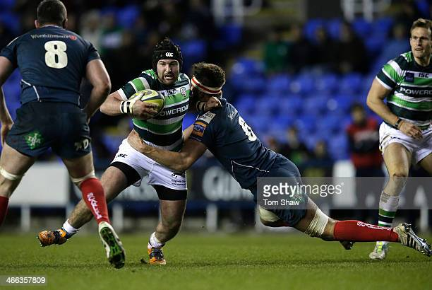 Jimmy Stevens of London Irish is tackled during the LV= Cup Match between London Irish and Scarlets at the Madejski Stadium on February 1 2014 in...
