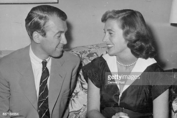 Jimmy Stewart movie star and his bride the former Gloria Hatrick McLean relax in their suite at the Broadmoor hotel Colorado Springs after driving...