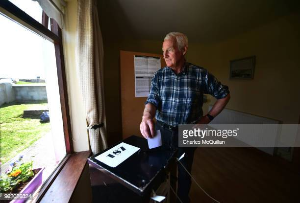 Jimmy Sweeney casts his vote in the abortion referendum as voting takes place a day earlier than the main land on May 24 2018 in Gola Island Ireland...