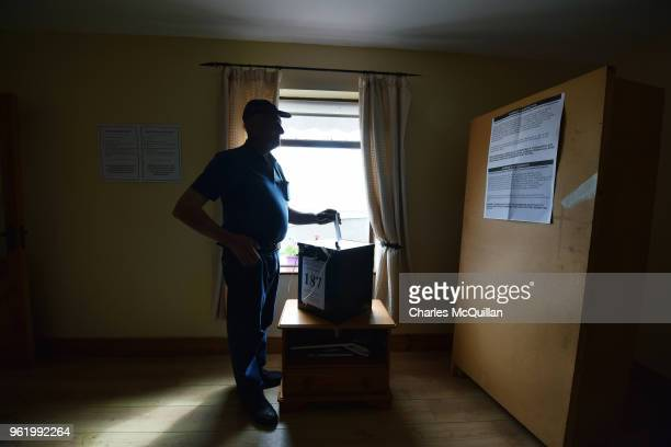 Jimmy Sweeney casts the first vote in the abortion referendum as voting takes place a day earlier than the main land on May 24 2018 in Gola Island...