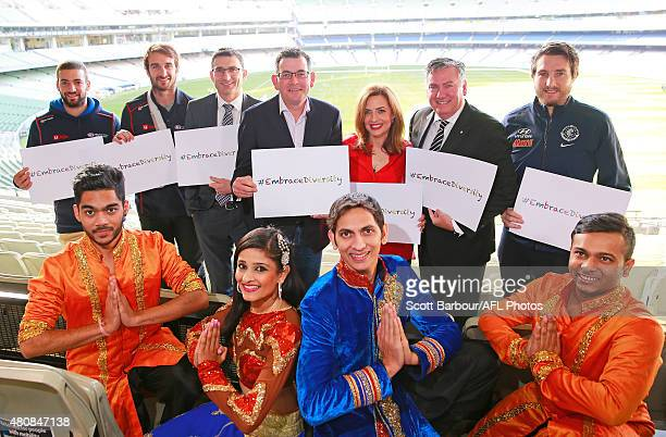 Jimmy Toumpas of the Demons Jobe Watson of the Bombers AFL General Manager Clubs and AFL Operations Travis Auld Premier of Victoria Daniel Andrews...
