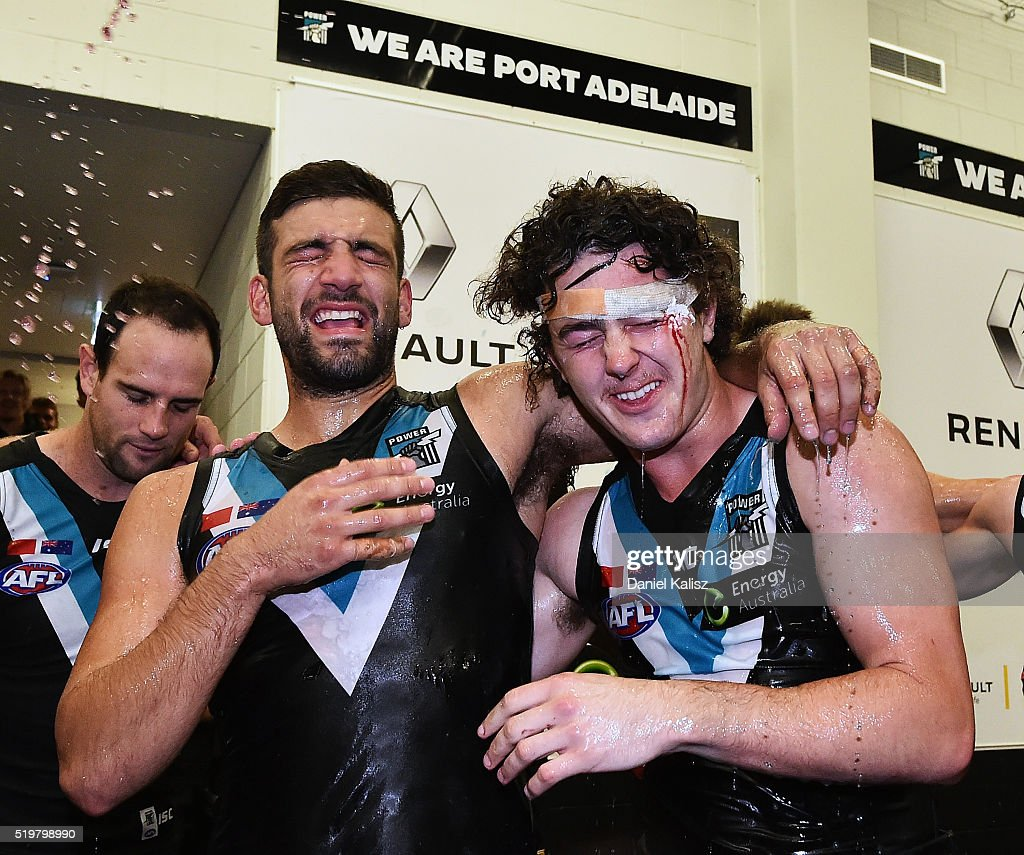 Jimmy Toumpas of the Power and Darcy Byrne-Jones of the Power receive a gatorade shower as they sing the club song after the round three AFL match between the Port Adelaide Power and the Essendon Bombers at Adelaide Oval on April 8, 2016 in Adelaide, Australia.