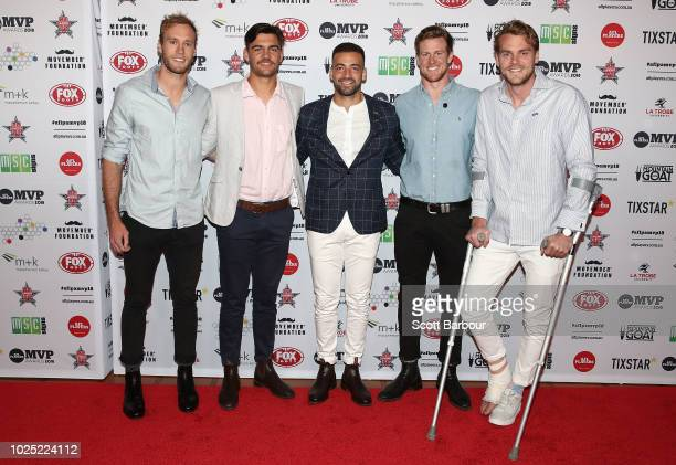 Jimmy Toumpas of the Power and Jack Watts of the Power pose during the 2018 AFL Players' MVP Awards at the Basement on August 30 2018 in Melbourne...
