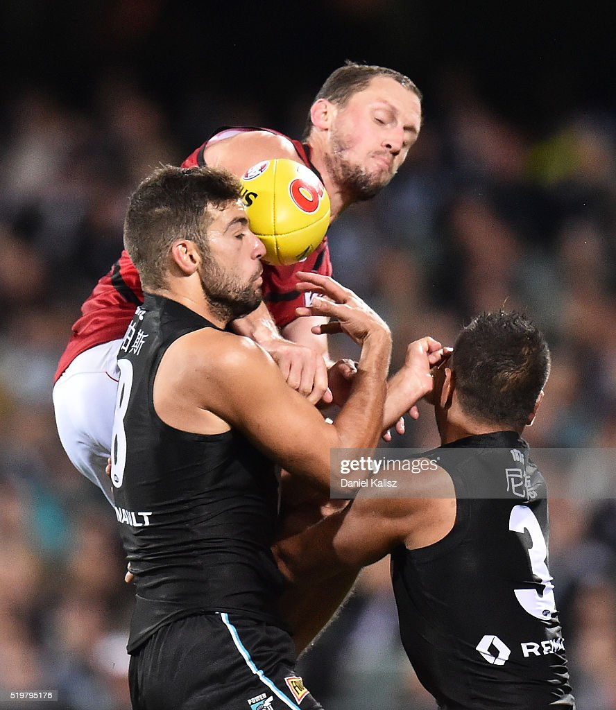 Jimmy Toumpas of the Power collides with his team mate Jake Neade of the Power after competing for the ball with James Kelly of the Bombers during the round three AFL match between the Port Adelaide Power and the Essendon Bombers at Adelaide Oval on April 8, 2016 in Adelaide, Australia.
