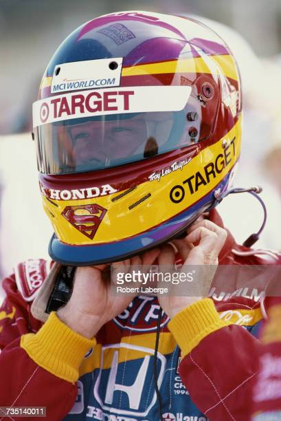 Jimmy Vasser of the United States driver the Target Chip Ganassi Racing Reynard 99i Honda puts on his helmet during practice for the Championship...