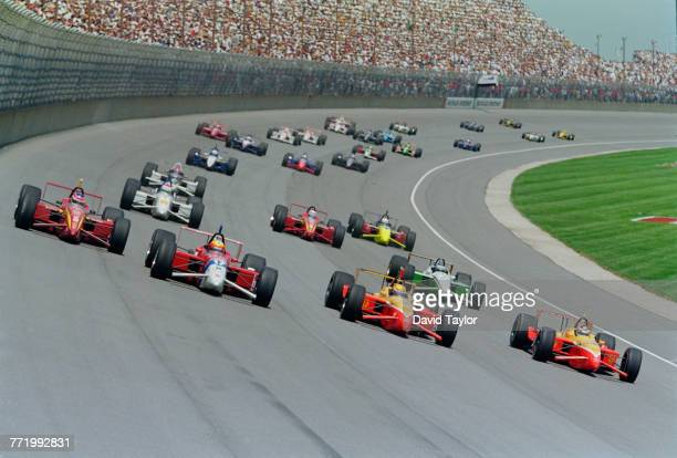 Jimmy Vasser of the United States driving the Target Chip Ganassi Racing Reynard 97i Honda races alongside Mauricio Gugelmin in the PacWest Hollywood...