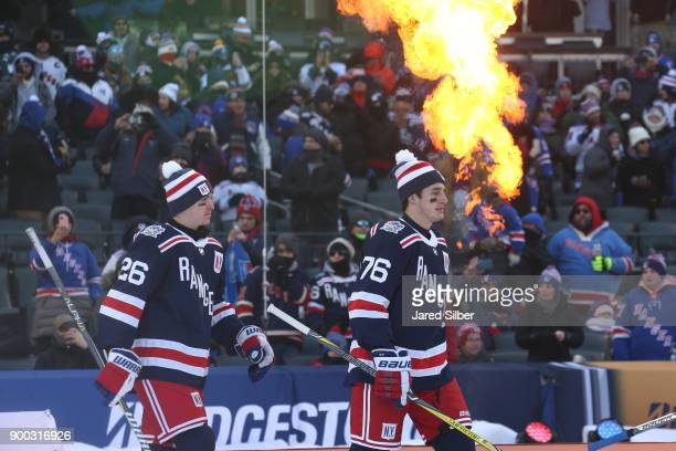 Jimmy Vesey and Brady Skjei of the New York Rangers walk to the ice prior to the game against the Buffalo Sabres during the 2018 Bridgestone NHL...