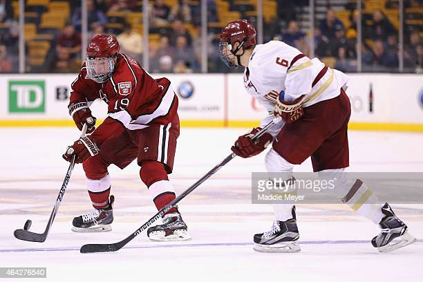 Jimmy Vesey of the Harvard Crimson skates against Steve Santini of the Boston College Eagles during the second period of the 2015 Beanpot Tournament...