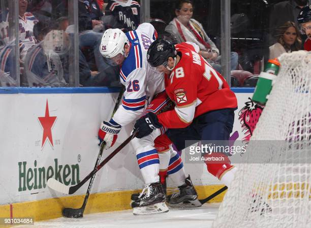 Jimmy Vesey of the New York Rangers and Maxim Mamin of the Florida Panthers battle for possession of the puck at the BBT Center on March 10 2018 in...