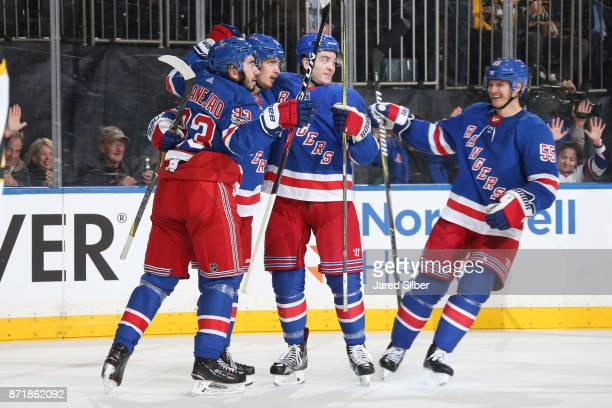 Jimmy Vesey of the New York Rangers celebrates his second goal of the game with teammates in the first period against the Boston Bruins at Madison...
