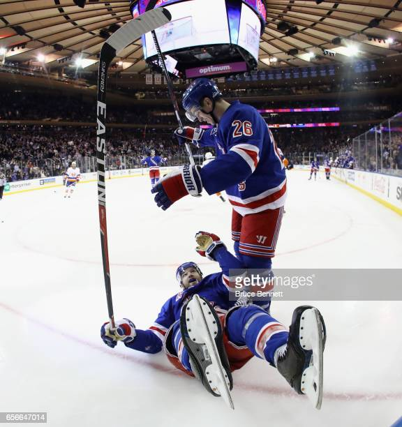 Jimmy Vesey of the New York Rangers congratulates Rick Nash on his second period goal against the New York Islanders at Madison Square Garden on...