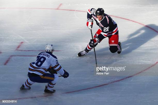 Jimmy Vesey of the New York Rangers drives to the net as Zemgus Girgensons of the Buffalo Sabres defends during the 2018 Bridgestone NHL Winter...