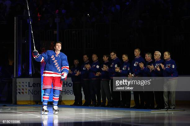 Jimmy Vesey of the New York Rangers is introduced during the home opener prior to the game against the New York Islanders at Madison Square Garden on...