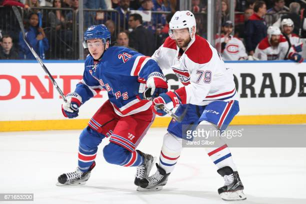Jimmy Vesey of the New York Rangers skates against Andrei Markov of the Montreal Canadiens in Game Six of the Eastern Conference First Round during...