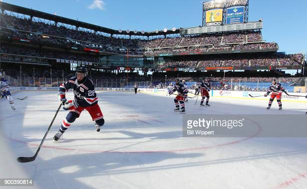 Jimmy Vesey of the New York Rangers skates for the puck against the Buffalo Sabres in front of 41821 fans at the 2018 Bridgestone NHL Winter Classic...