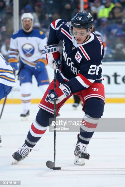 Jimmy Vesey of the New York Rangers skates with the puck against the Buffalo Sabres during the 2018 Bridgestone NHL Winter Classic at Citi Field on...