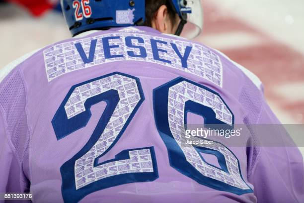 Jimmy Vesey of the New York Rangers sports a special warmup jersey as part of Hockey Fights Cancer Awareness Night at Madison Square Garden before...