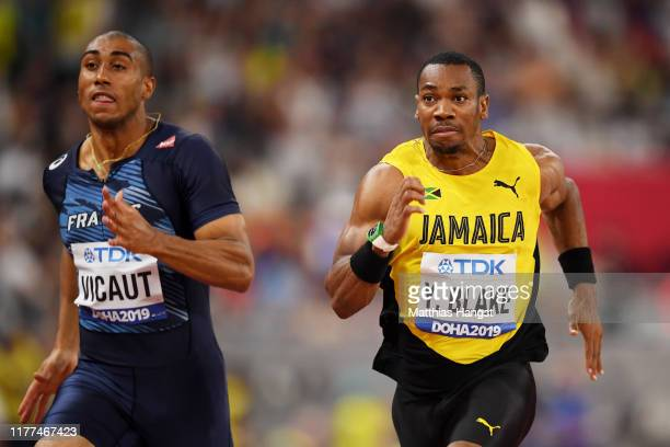 Jimmy Vicaut of France and Yohan Blake of Jamaica compete in the Men's 100 metres heats during day one of 17th IAAF World Athletics Championships...