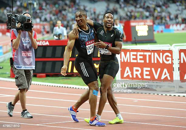 Jimmy Vicaut of France celebrates with countryman Emmanuel Biron after beatine the french 100m record during the Meeting AREVA of the IAAF Diamond...