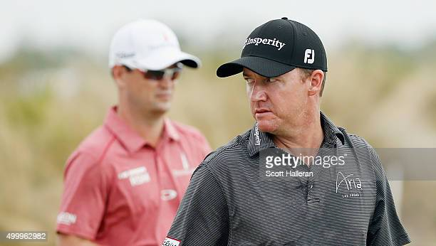Jimmy Walker and Zach Johnson of the United States walk together on the second hole during the second round of the Hero World Challenge at Albany,...