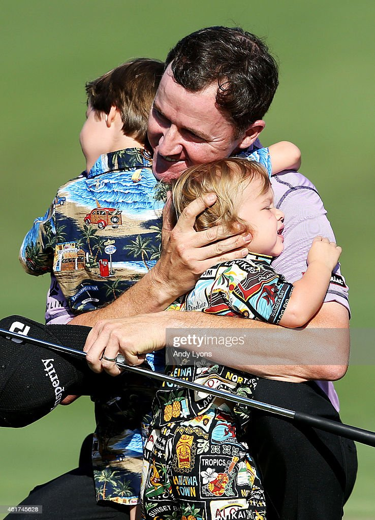 Jimmy Walker celebrates with his sons Mclain and Beckett after winning the final round of the Sony Open In Hawaii at Waialae Country Club on January 18, 2015 in Honolulu, Hawaii.