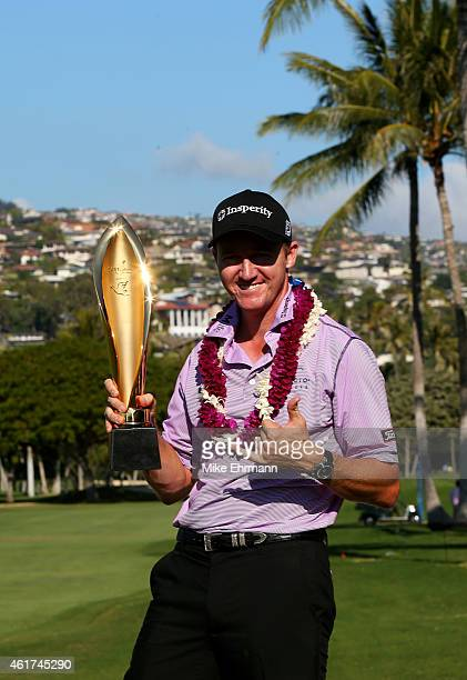 Jimmy Walker celebrates with the winner's trophy after the final round of the Sony Open In Hawaii at Waialae Country Club on January 18 2015 in...
