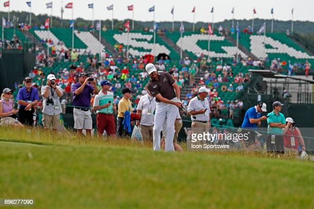Jimmy Walker chips on the 8th hole during a practice round for the 117th US Open at Erin Hills in Erin Wisconsin