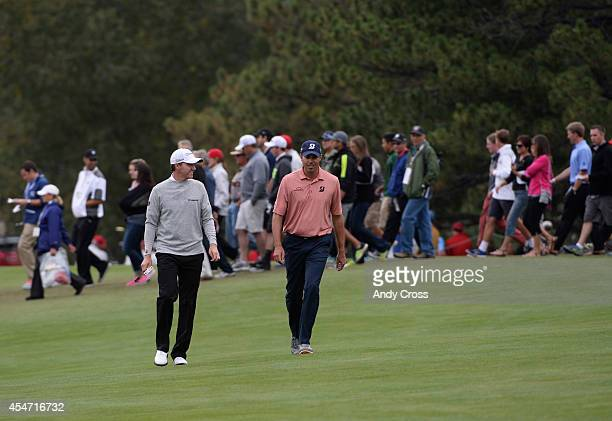 Jimmy Walker left and Matt Kuchar walk up the 9th fairway to the green during the second round of the FedExCup BMW Championship at the Cherry Hills...