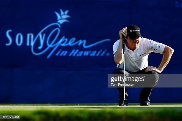 Jimmy Walker lines up a putt on the 17th hole during the final round of the Sony Open in Hawaii at Waialae Country Club on January 12 2014 in...