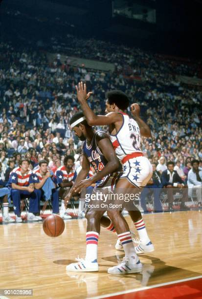 Jimmy Walker of the Kansas City Kings is closely guarded by Dave Bing of the Washington Bullets during an NBA basketball game circa 1975 at the...