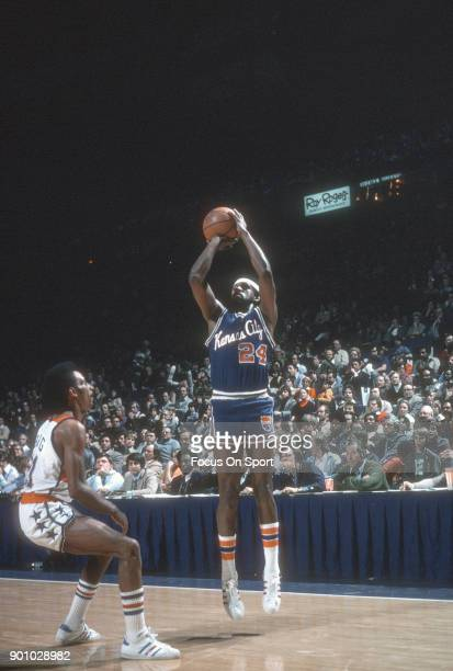 Jimmy Walker of the Kansas City Kings shoots over Dave Bing of the Washington Bullets during an NBA basketball game circa 1975 at the Capital Centre...