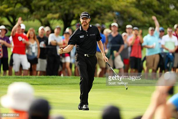 Jimmy Walker of the United States celebrates a putt for birdie on the 11th hole during the final round of the 2016 PGA Championship at Baltusrol Golf...