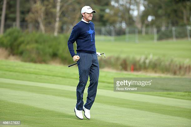 Jimmy Walker of the United States celebrates on the 15th hole during the Morning Fourballs of the 2014 Ryder Cup on the PGA Centenary course at the...