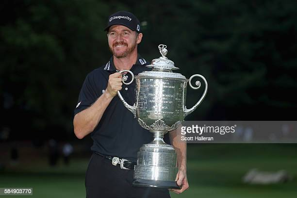 Jimmy Walker of the United States celebrates with the Wanamaker Trophy after winning the 2016 PGA Championship at Baltusrol Golf Club on July 31,...
