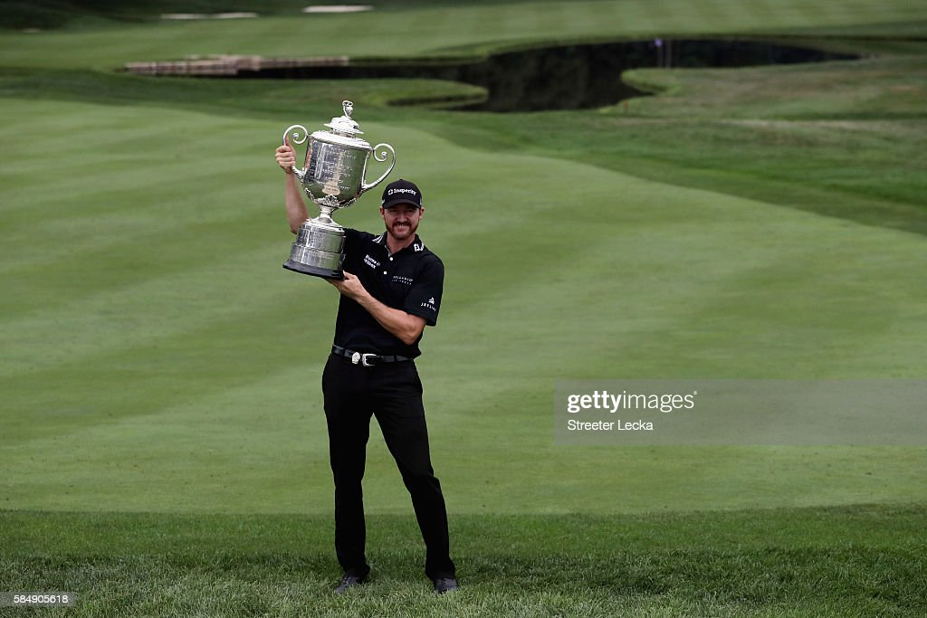 Jimmy Walker of the United States celebrates with the Wanamaker Trophy after winning the 2016 PGA Championship at Baltusrol Golf Club on July 31, 2016 in Springfield, New Jersey.