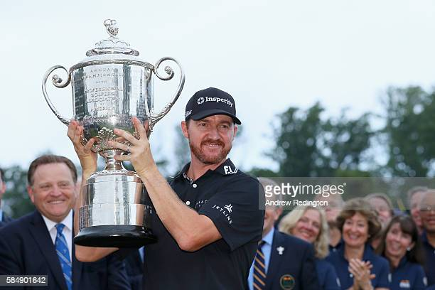 Jimmy Walker of the United States celebrates with the Wanamaker Trophy during the trophy presentation ceremony after winning the 2016 PGA...