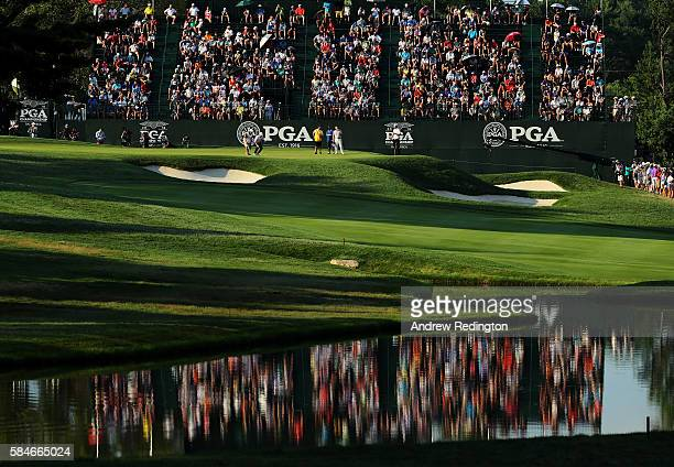 Jimmy Walker of the United States lines up a putt on the 18th green during the second round of the 2016 PGA Championship at Baltusrol Golf Club on...