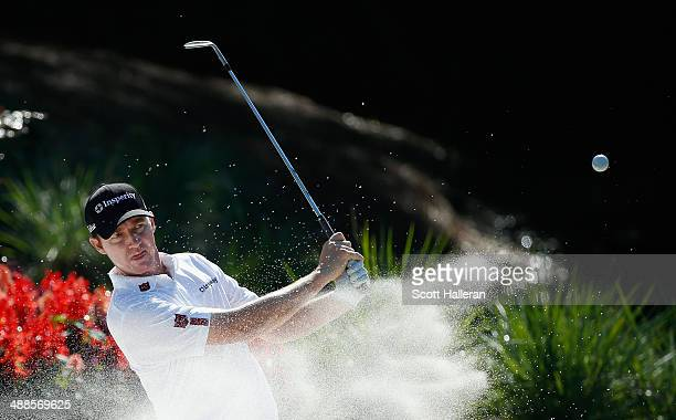 Jimmy Walker of the United States plays a bunker shot during a practice round ahead of THE PLAYERS Championship on The Stadium Course at TPC Sawgrass...