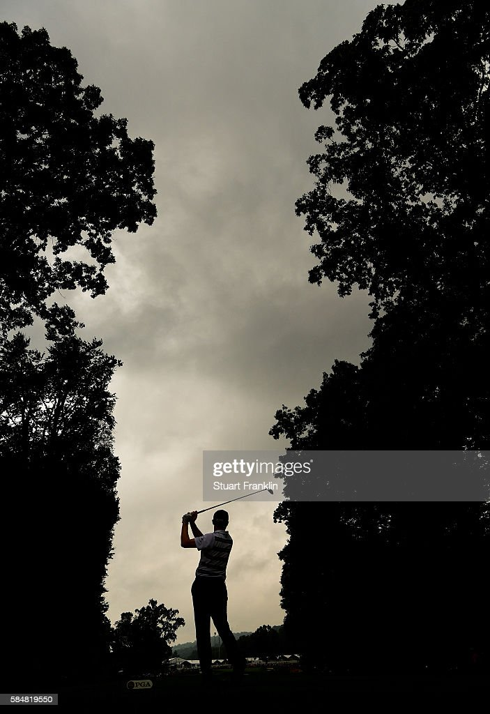 Jimmy Walker of the United States plays his shot from the fifth tee during the continuation of the weather delayed third round of the 2016 PGA Championship at Baltusrol Golf Club on July 31, 2016 in Springfield, New Jersey.