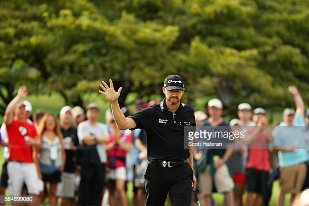 Jimmy Walker of the United States reacts to fans after making birdie on the 11th hole during the final round of the 2016 PGA Championship at...