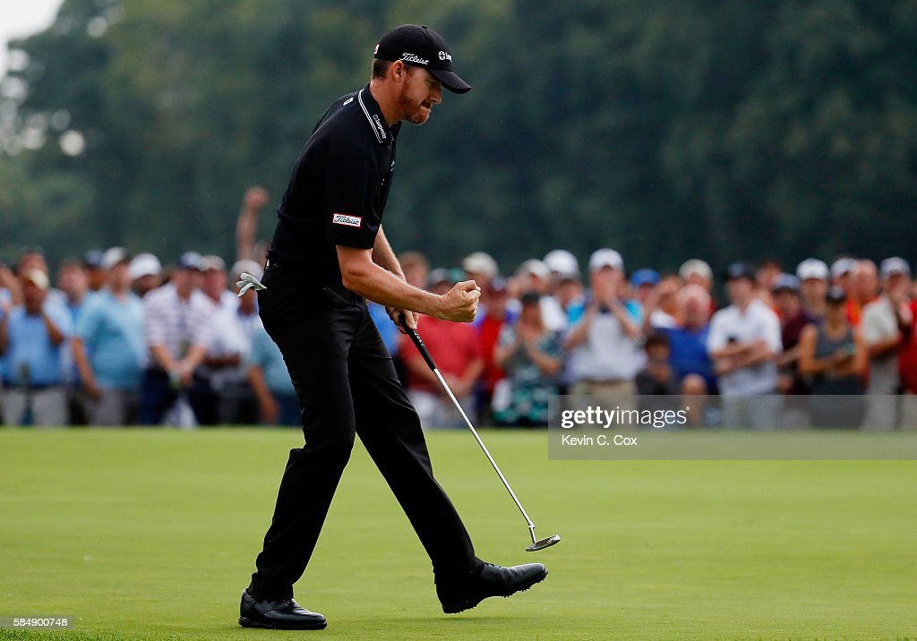Jimmy Walker of the United States reacts to his birdie putt on the 17th hole during the continuation of the final round of the 2016 PGA Championship at Baltusrol Golf Club on August 1, 2016 in Springfield, New Jersey.