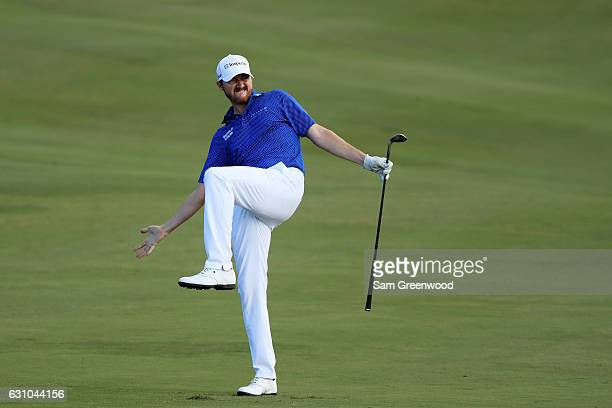 Jimmy Walker of the United States reacts to his third shot on the 18th hole during the first round of the SBS Tournament of Champions at the...