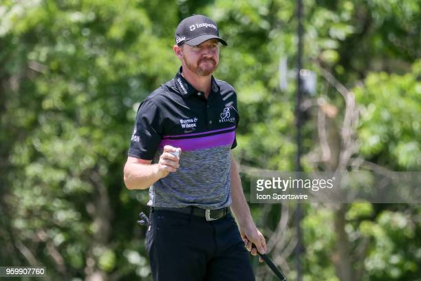 Jimmy Walker of the United States waves at the gallery after finishing his second round of the 50th anniversary AT&T Byron Nelson on May 18, 2018 at...