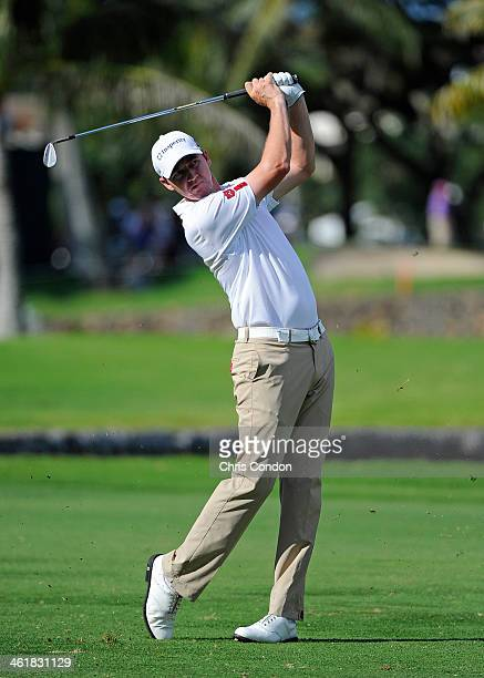 Jimmy Walker plays his second shot on the second hole during the third round of the Sony Open in Hawaii at Waialae Country Club on January 11 2014 in...