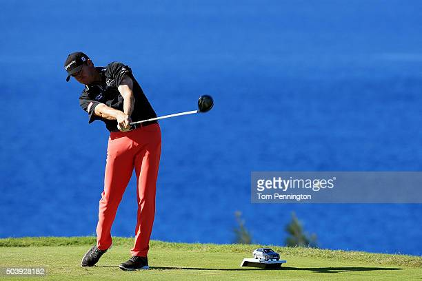 Jimmy Walker plays his shot from the 13th tee during round one of the Hyundai Tournament of Champions at the Plantation Course at Kapalua Golf Club...
