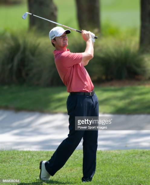 Jimmy Walker takes his second shot on the twelfth fairway during Round 2 of the CIMB Asia Pacific Classic 2011 at the MINES resort and golf club on...
