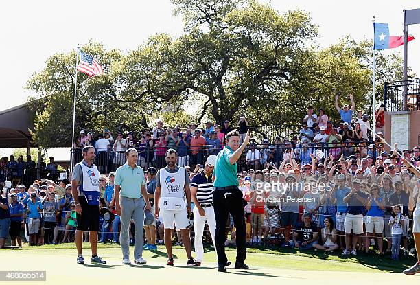 Jimmy Walker waves to fans after winning the Valero Texas Open in the final round at TPC San Antonio ATT Oaks Course on March 29 2015 in San Antonio...