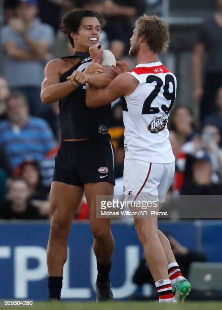 Jimmy Webster of the Saints and Jack Silvagni of the Blues wrestle during the AFL 2018 JLT Community Series match between the Carlton Blues and the...