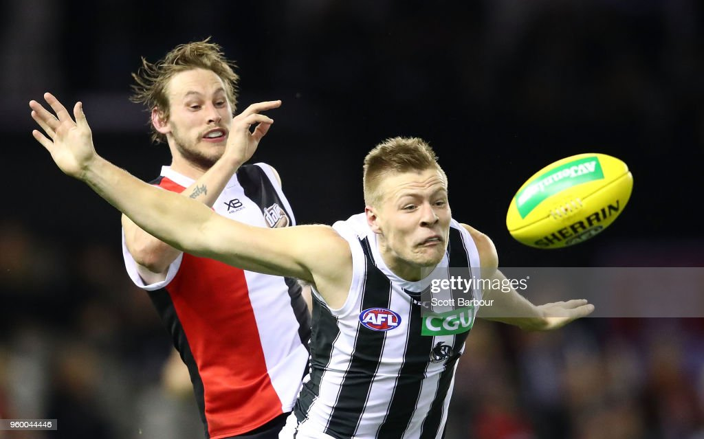 Jimmy Webster of the Saints and Jordan De Goey of the Magpies compete for the ball during the round nine AFL match between the St Kilda Saints and the Collingwood Magpies at Etihad Stadium on May 19, 2018 in Melbourne, Australia.