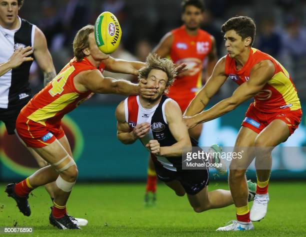 Jimmy Webster of the Saints is collected high during the round 14 AFL match between the St Kilda Saints and the Gold Coast Suns at Etihad Stadium on...